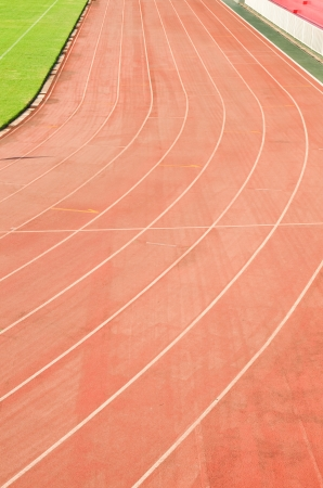 running track rubber standard red color photo