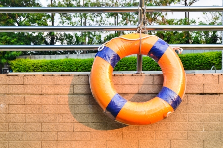 Life Buoy attached to a swimming pool Wall photo