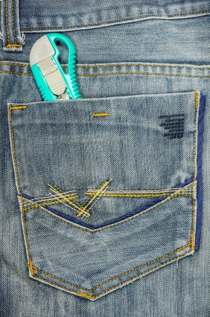 Cutter in jeans pocket  Stock Photo - 18840453