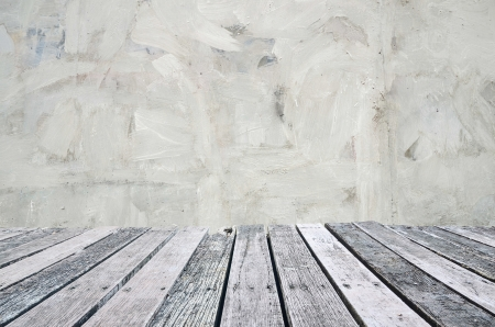 Grunge cement wall with wooden plank floor  photo