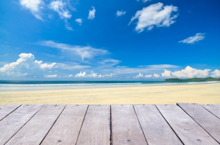 beach and blue sky with clouds and wood planks floor background