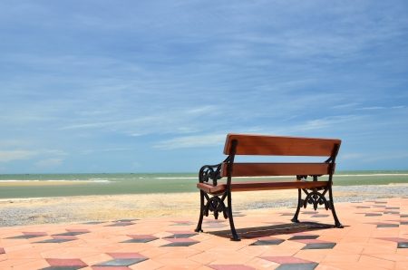 Bench near the beach and clear blue sky Stock Photo