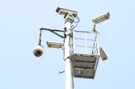security surveillance cameras at intersection traffic lights photo