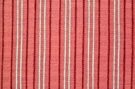 Fabric texture in red stripes close up photo