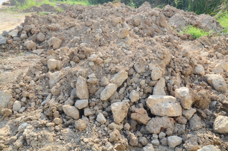 piles of land and stones mined by excavation in construction site Stock Photo