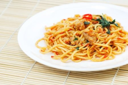 Thai spicy fried noodle with pork photo