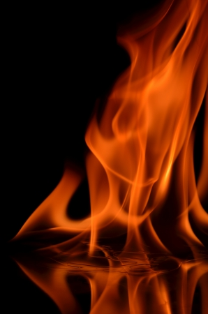 Fire flames with reflection on black background Stock Photo - 22227412