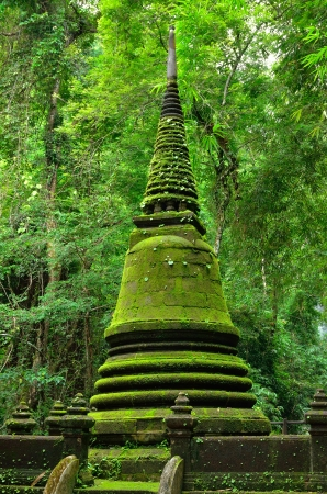 Old pagoda cover by moss at Phlio waterfall national park , Chanthaburi , Thailand