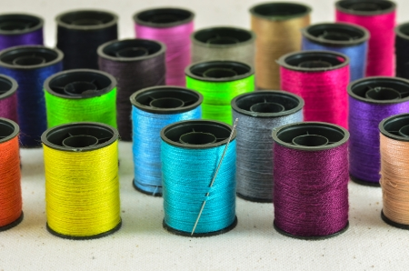 colored spools of threads Stock Photo