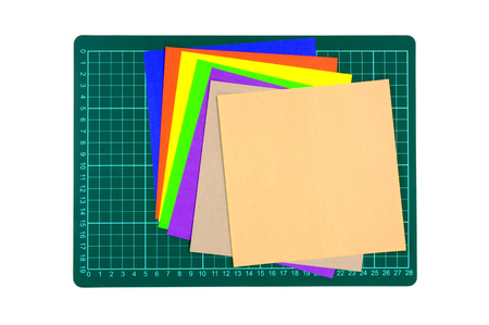 Cutting mats and multi color paper isolated on white background Stock Photo