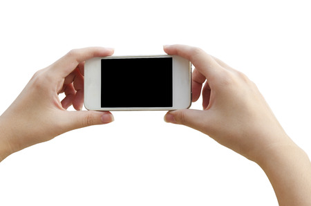 woman hand holding the phone tablet photo