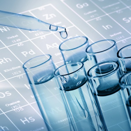 medical lab: science laboratory test tubes with periodic table background Stock Photo
