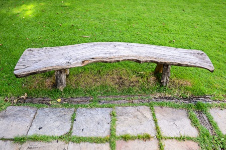 wood bench in park photo