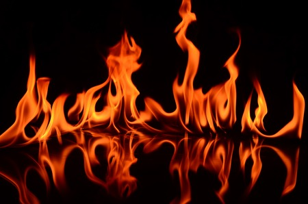 demonic: Fire flames on a black background Stock Photo