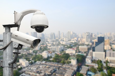 city surveillance: Surveillance Security Camera or CCTV over city Stock Photo