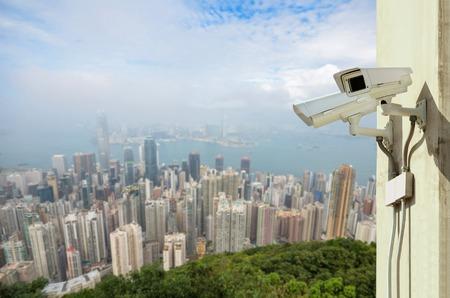 electronic survey: Surveillance Security Camera or CCTV over city Stock Photo