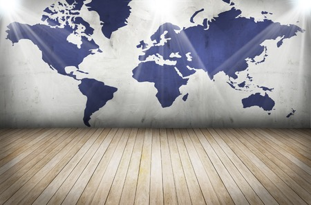 industry moody: world map on grunge wall and wooden floor