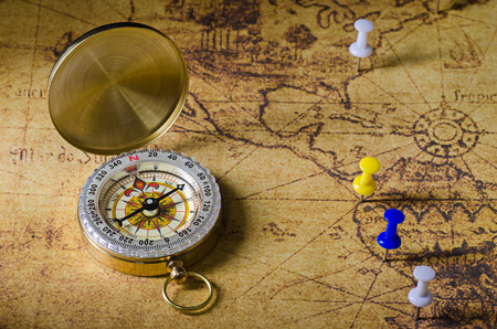 compass with marked location on old map photo