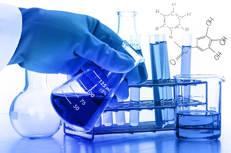 scientist hand holding laboratory test tubes