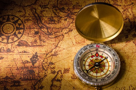 Compass on old map Archivio Fotografico