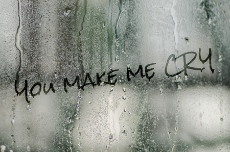 steamy: natural water drops on glass window with the text you make me cry