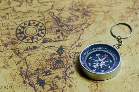 old page: Compass on old map Stock Photo