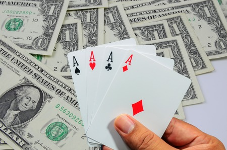 winning stock: Hand and four aces , playing cards