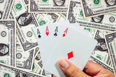aces: Hand and four aces , playing cards