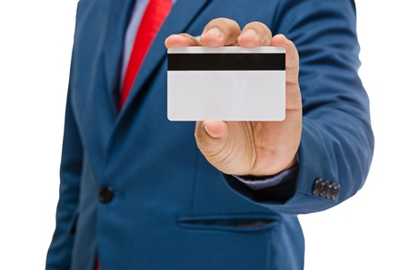 man holding card: business man holding card in hand isolated on white background