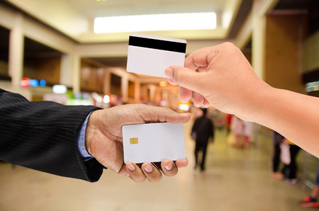 smart card: hand holding a blank smart card on blur background