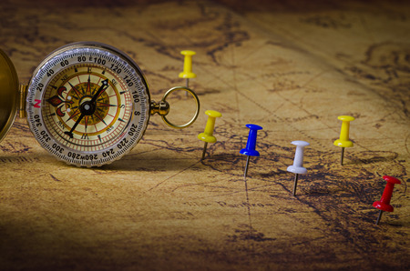 compass with marked location on old map