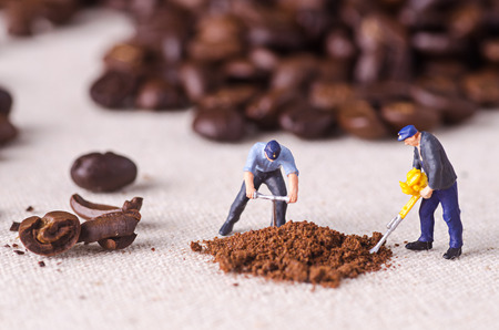 miniature people: Miniature people working on coffee blend process