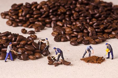 Miniature people working on coffee blend process