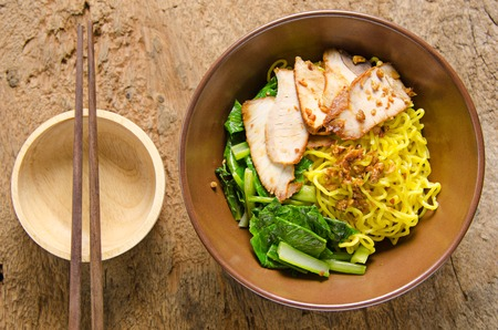 dry food: Yellow noodles served with sliced pork