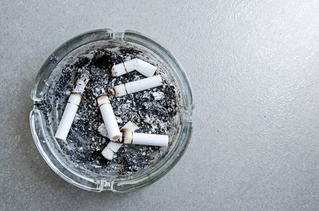 investigated: Ashtray with full of smoked cigarettes