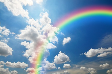 nimbi: Rainbow and White clouds in blue sky background