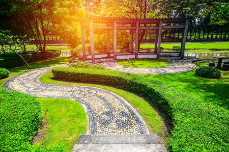 summerhouse: curving walkway in the garden