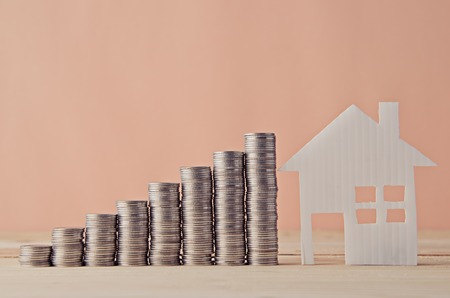 save: House model and stack of coin