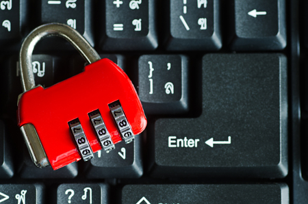 red metal: red metal security lock on keyboard Stock Photo