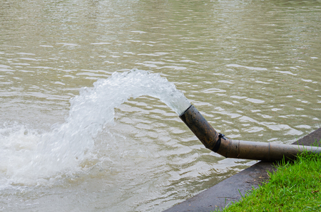 Water pouring out from drain water pipe Stock Photo