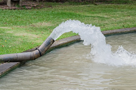 drain water: Water pouring out from drain water pipe Stock Photo