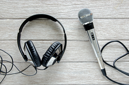 retro microphone: microphone and headphone on white wooden table