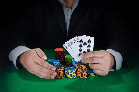 jack of diamonds: business man win poker game with royal flush in hand
