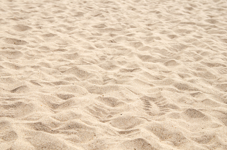 voet afdrukken op het zand strand
