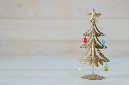 gold tree: gold christmas tree on wooden table Stock Photo