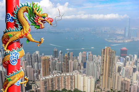festival scales: Chinese style dragon statue with cityscape background in vintage tone Stock Photo