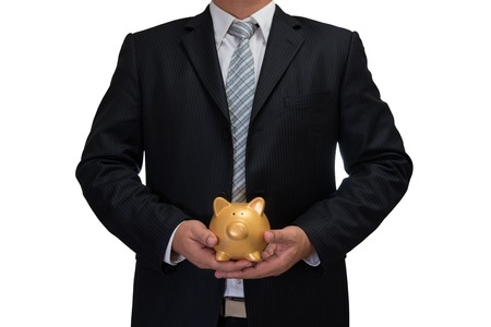 man in suite: business man in black suite with gold piggy bank isolated on white background
