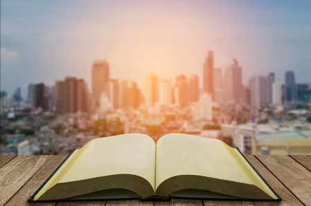 open book with modern city background