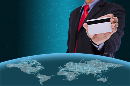 smart card: business man holding smart card with world map