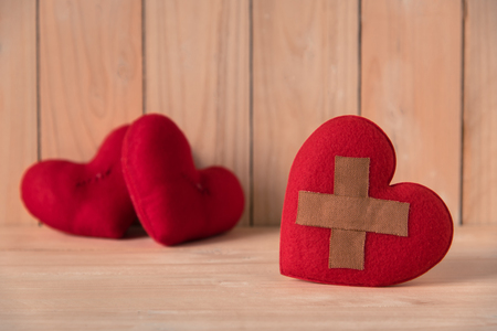 wound heart with couple red heart background